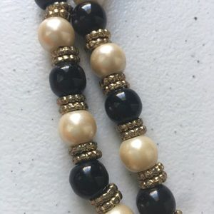 Long beaded necklace with gold accents